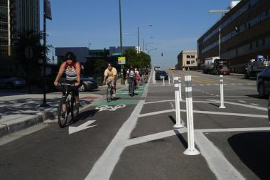 An example of a barrier-protected bike lane from the Chicago Department of Transportation website is shown. This lane was installed on Kinzie Street between Milwaukee Avenue and Wells Street in 2011.