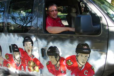 John Tolley of Morgan Park hand painted his 2004 Econoline van in celebration of the Chicago Blackhawks 2013 championship season.