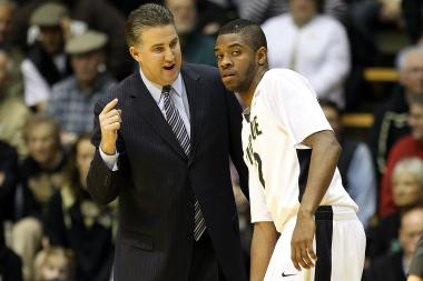 Former Purdue guard Kelsey Barlow talks to Boilermakers head coach Matt Painter during the 2010-11 season. Barlow transferred to UIC after three seasons in West Lafayette, where he was dismissed from the team for violating team rules.