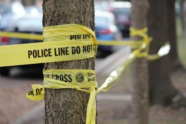 A 39-year-old woman was killed Thursday morning in the 4800 block of North Moody Avenue when a man slit her throat, police and neighbors said.