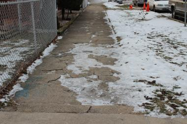 The city's Shared Cost Sidewalk Program will begin accepting applications at the stroke of midnight Jan. 1, which could be used to fix the broken and icy sidewalk at Lamon and Sunnyside avenues.