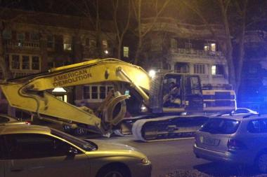 A 53-ton excavator from American Demolition snarled traffic on Hyde Park Boulevard Friday night.