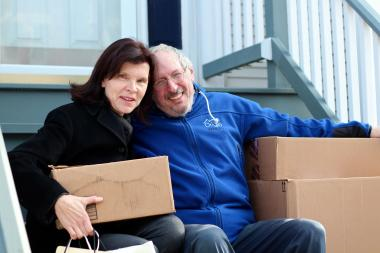 Bernadette Pawlik and her husband Jeff Dorman on the front steps of their Lincoln Park home, which serves as the drop-off point for donations.