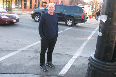 Tedd stands near the Lincoln Park crosswalk on Halsted Street where his car was improperly ticketed.