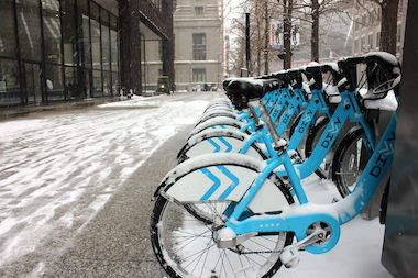 Dusted Divvy bikes parked outside the Daley Center got less play than usual during the first snowstorm of 2014.