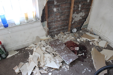 The basement where the 16 and 18-year-old were shot to death Saturday remained in tatters Sunday.