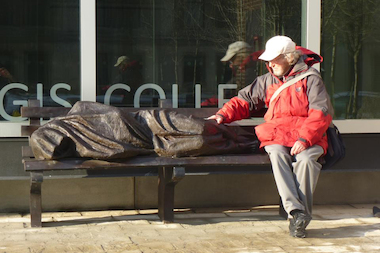 "Canadian artist Timothy Schmalz said he wanted to challenge people with his ""Jesus the Homeless"" sculpture. Jesus sleeps wrapped in a blanket on a park bench. His face is covered, but puncture wounds on his feet are a nod to the crucifixion."