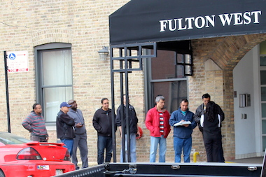 "Cabbies line up outside a West Loop office Thursday to ""check out"" an invitation to drive for UberX."