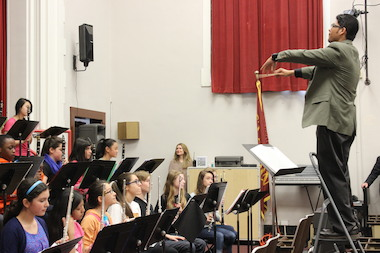 Peterson Elementary teacher Anand Sukumaran leads the school band Thursday.