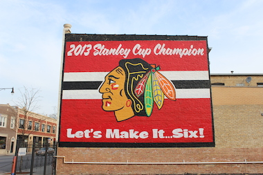 The red, black and white mural featuring the Blackhawks' Indianhead logo became a neighborhood landmark.