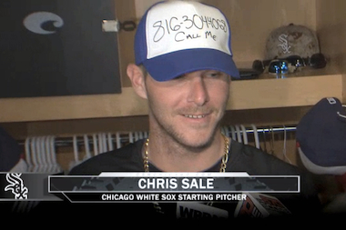 "White Sox Ace Chris Sale punked pitcher Scott Carroll by putting the rookie's cell phone number on his ""Doodle Hat,"" a dry-erase ball cap that Carroll holds a financial stake in."