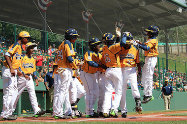 Jackie Robinson West players celebrate at home plate during the Little League World Series.