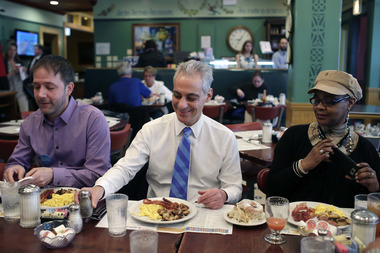 Mayor Rahm Emanuel eats breakfast at Ann Sather's with his campaign workers.