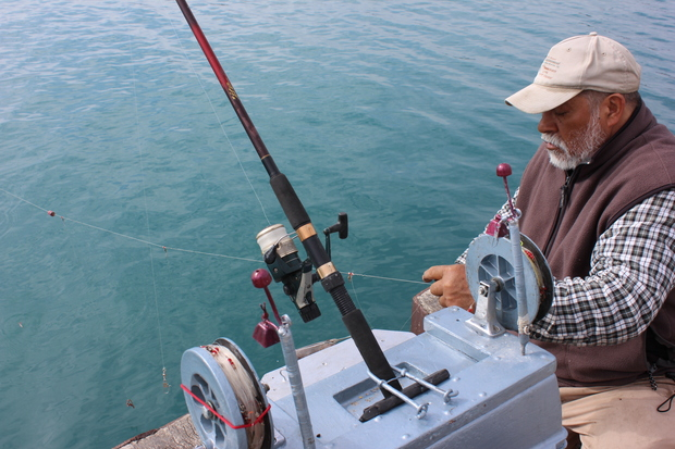 Chicago 39 s 39 fish magnet 39 uses a fire extinguisher baby for Fishing in chicago