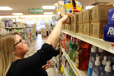 Jane Zia stocks the shelves of County Fair Foods with her handmade soap on Monday. Zia, a lifelong Morgan Park resident, began selling her Our Secret Garden line of soaps at the neighborhood grocery store in February.