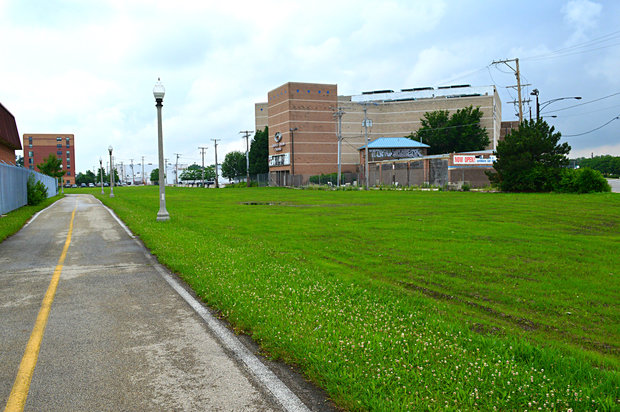 The parking lot for the former Cineplex Odeon Cinemas on McCormick Road sat empty for a decade before being torn up to make way for fresh grass.