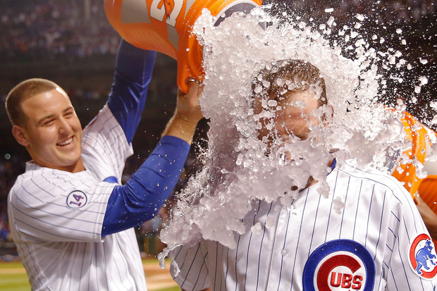 Cubs players like to dump stuff on teammates' heads, like Anthony Rizzo does here to Chris Denorfia.