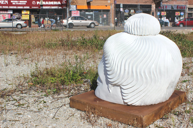 <p>A Buddha statue gazes out from a vacant lot at the southeast corner of Lawrence and Central Park Avenues.</p>