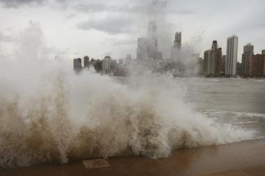 Waves generated from the remnants Hurricane Sandy crash into the shoreline of Lake Michigan on Tuesday in Chicago.