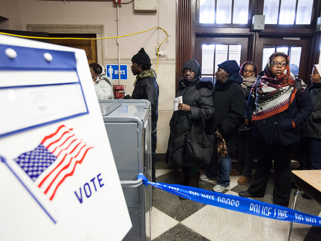 <p>People enter the Far Rockaway High School on Election Day to vote on Nov. 6th, 2012.</p>