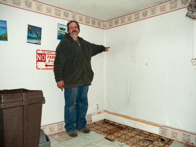 <p>John Greenholtz points to a watermark in his basement at 95-19 159th Avenue, showing how high the flood waters rose on Tuesday November 06th, 2012.</p>