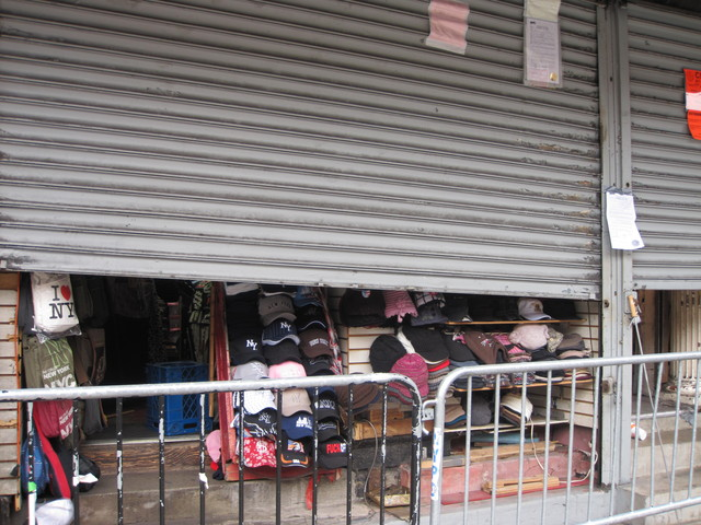 <p>Shuttered storefronts on the south side of Canal Street between Broadway and West Broadway. Police raided 10 buildings housing 31 stalls on Dec. 8, 2009, seizing knock-off handbags, watches and wallets as a part of crackdown on counterfeit sellers in the area.</p>