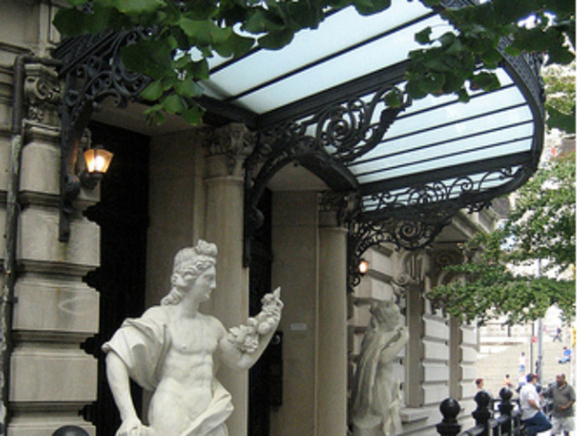 <p>French classical sculpture stands at the entrance to the Duke-Semans mansion on East 82nd Street, which sold for $40 million.</p>