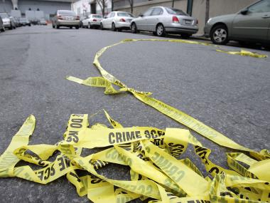 A man was rushed to the hospital after being shot in the head at Hollis Avenue and 205th Street in Queens on Feb. 13, 2012.