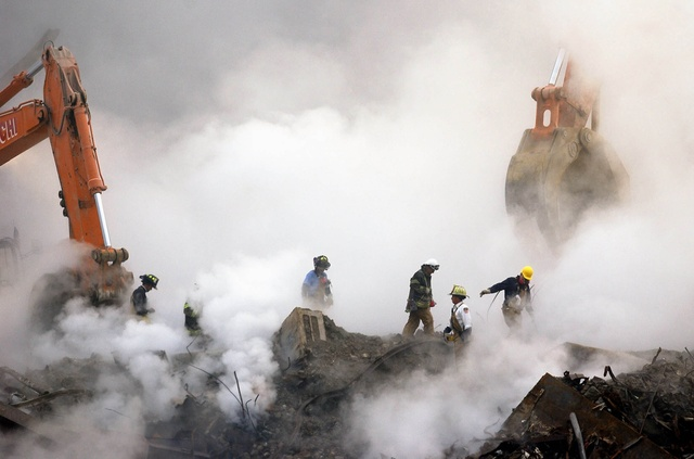 First responders battle clouds of dust and smoke at Ground Zero in October 2001.