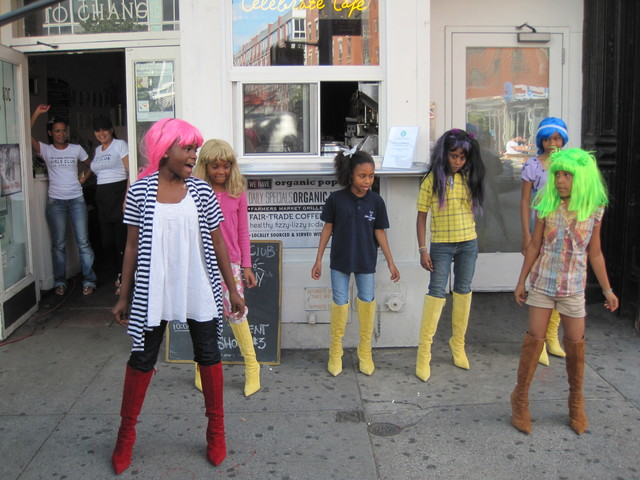 <p>LES Girls Club members put on a dance performance in front of their new Celebration Cafe on the Bowery.</p>