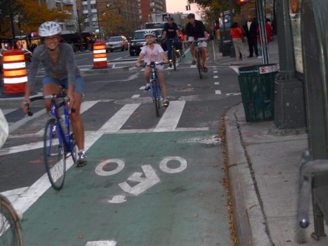 <p>Cyclists riding on Columbus Avenue&#39;s bike lane.&nbsp;</p>