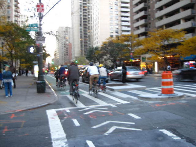 <p>Cyclists taking a celebratory ride down Columbus Avenue when the first bike lane was installed in 2011.</p>