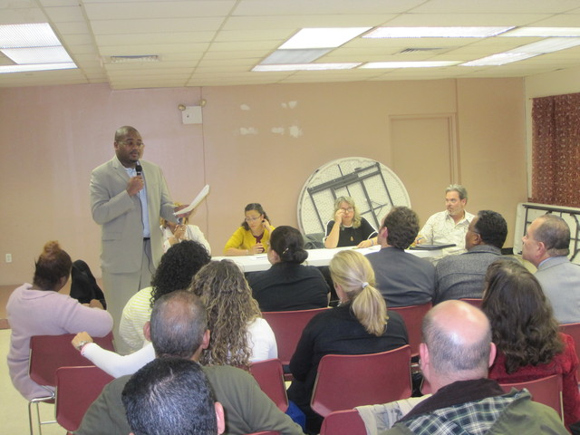 <p>Community Board 11 chair Matthew Washington addresses residents concerned about the future of Julia de Burgos Latino Cultural Center.</p>