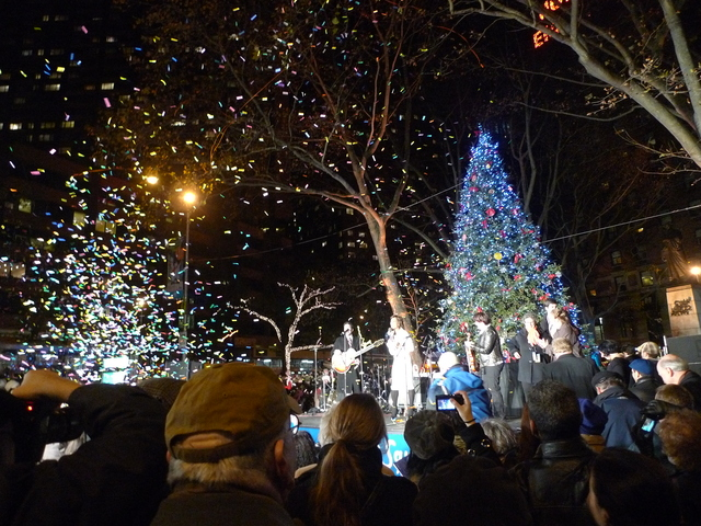 <p>A blast of confetti marked the lighting of a 27-foot Christmas tree at Dante Park to kick of Winter&#39;s Eve.</p>