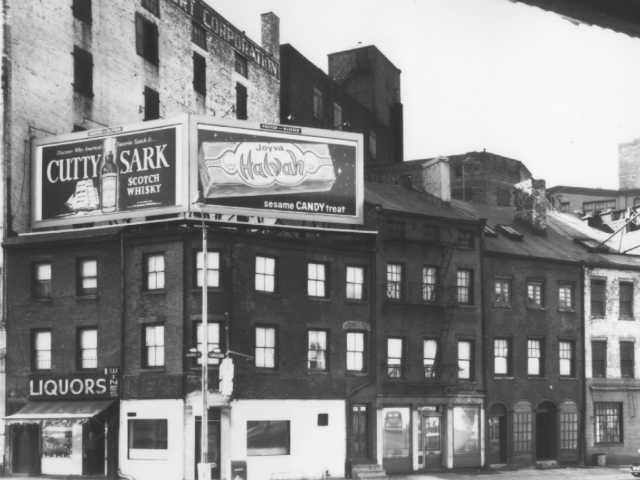 <p>The three-story building at 502 Canal St. and its neighbors, shown in 1965.</p>