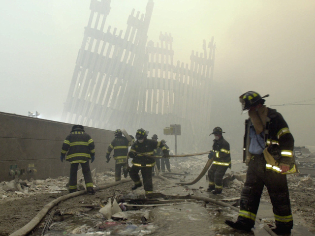 <p>Firefighters work at Ground Zero on 9/11 amid the toxic dust cloud.</p>