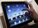 Taxi Cabs May Get iPads to Replace TVs, City Says
