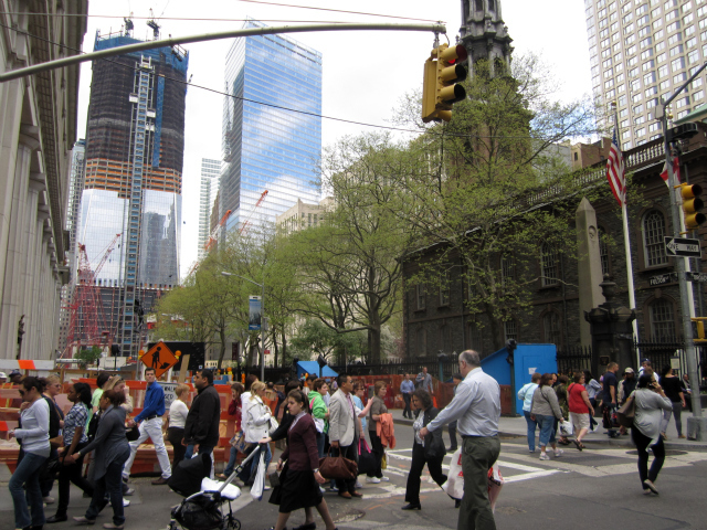 Tourists, workers and residents converge on Broadway near the World Trade Center