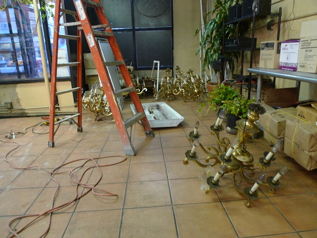 The chandeliers that once hung on H&H Bagels ceiling were replaced with flourescent lights on Monday.