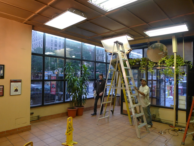 Workers stripped down H&H Bagels' West 80th Street store on Monday. Officials say it will likely close later this week.