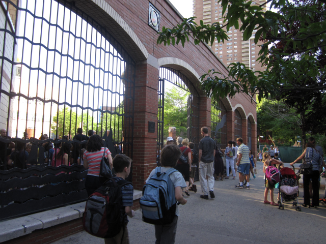 Students headed into the P.S. 234 schoolyard at the beginning of the school day recently. P.S. 234 is overcrowded and holds a lottery to decide who will be admitted.