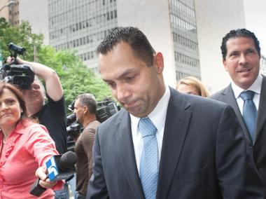 Kenneth Moreno (l.) leaves Manhattan Supreme Court followed by his lawyer, Joseph Tacopina (r.), May 26, 2011.