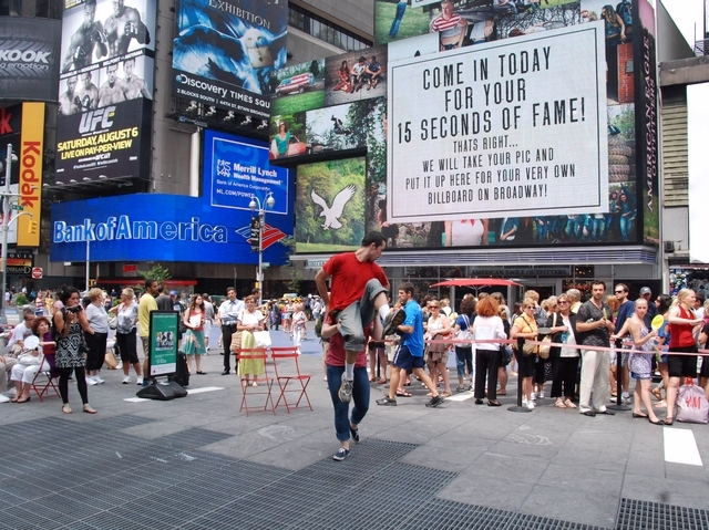 Dancers performed in front of people in Times Square in the morning on July 6, 2011.