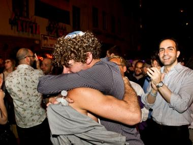 Erick Cohen, 20, (l) and his partner Noah, 21, got engaged outside the Stonewall Inn in Greenwich Village on June 24, 2011, after historic gay marriage legislation passed the state Senate.
