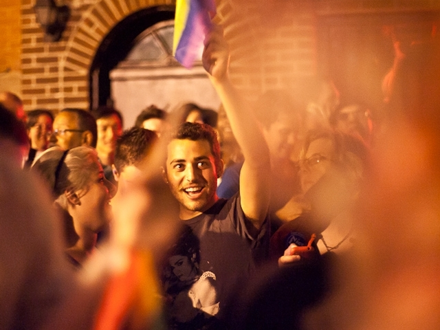 Revelers cheer the passage of historic gay marriage legislation outside the Stonewall Inn in the Village on June 24, 2011.