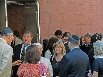 Family and friends mourn Marilyn Dershowtiz outside Riverside Memorial Chapel at 180 West 76th St. on July 5, 2011.