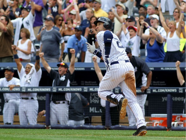 Derek Jeter rounds the bases after hitting a solo home run in the third inning for career hit 3000 while playing against the Tampa Bay Rays at Yankee Stadium on July 9, 2011.