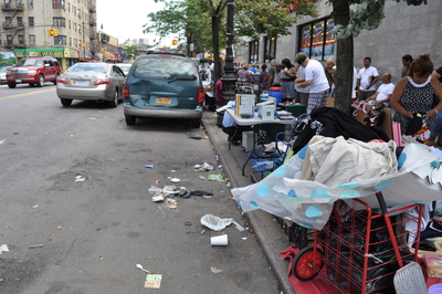 Piles of trash are strewn throughout Inwood.