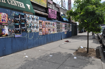 Trash flies around street corners in Inwood.