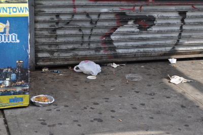 Trash outside a store on Sherman Avenue in Inwood.